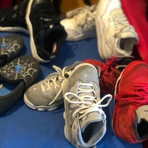 4 pair of Jordan's and one pair of slippers sz 11